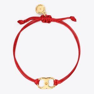 Tory Burch Foundation bracelets (two)